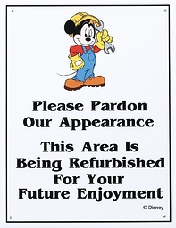 Mickey Mouse in a construction outfit. Please Pardon Our Appearance, This Area is Being Refurbished for your Future Enjoyment